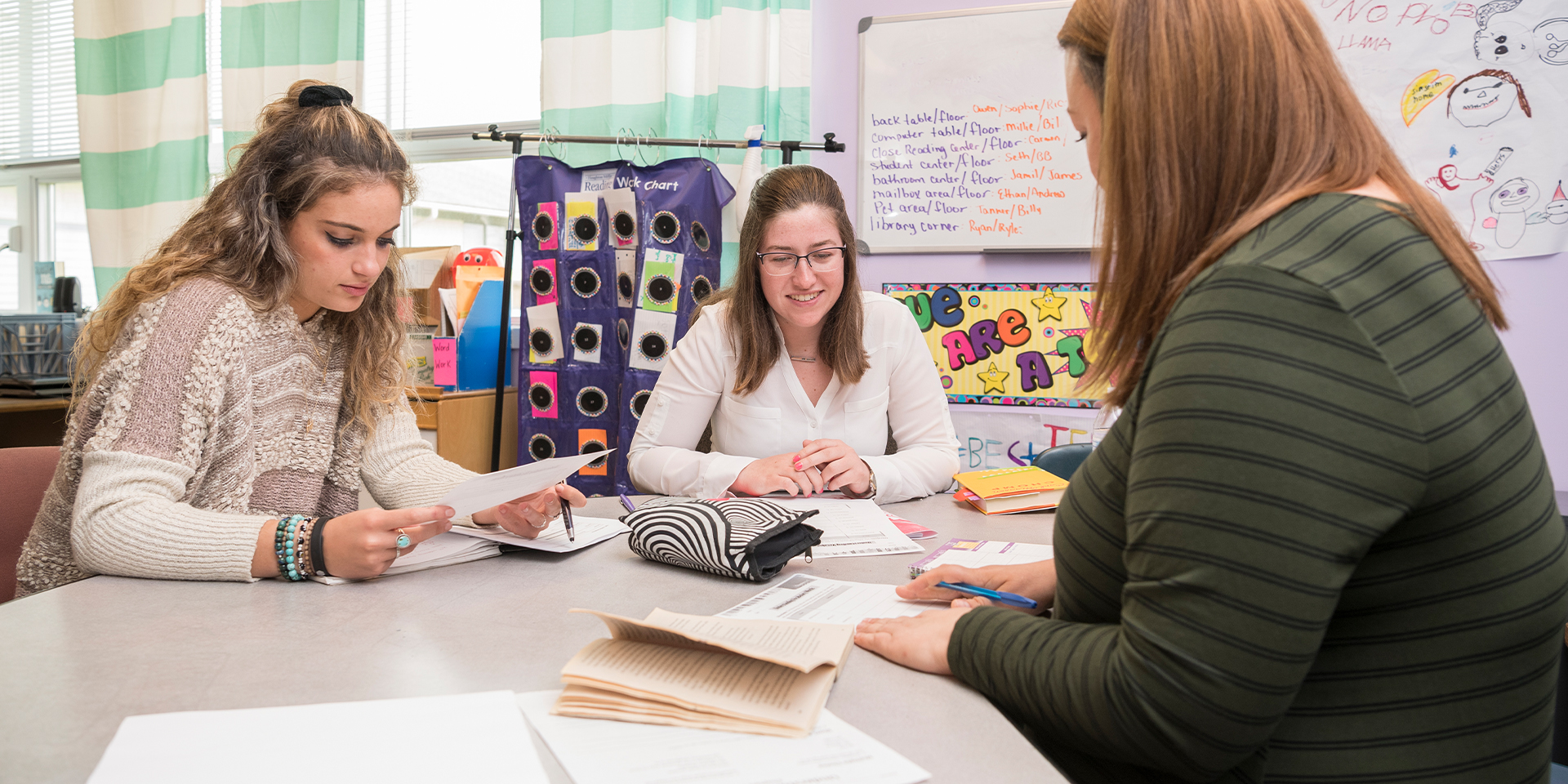 Clinical educator speaks to two student teachers