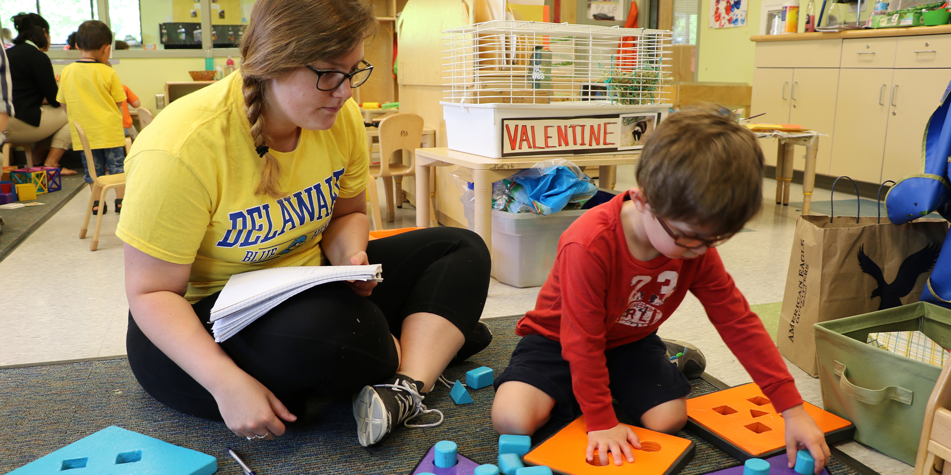 Student observes child at the Early Learning Center